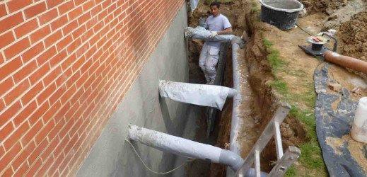 Cimentage hydrofuge et installation d'un drain (système Delta MS) à Auderghem